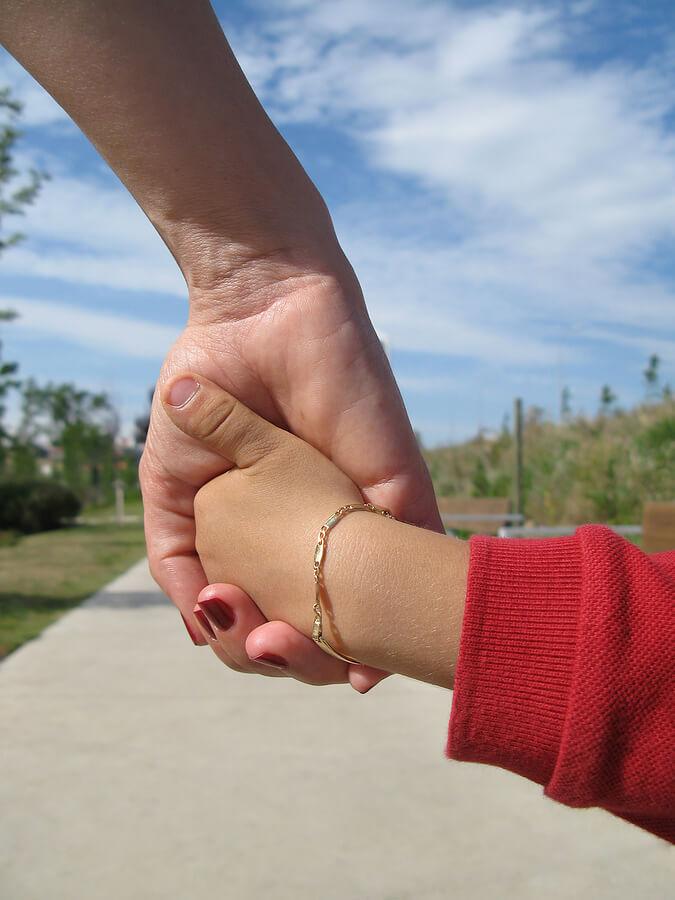 bigstock-Holding-Hands-1695390
